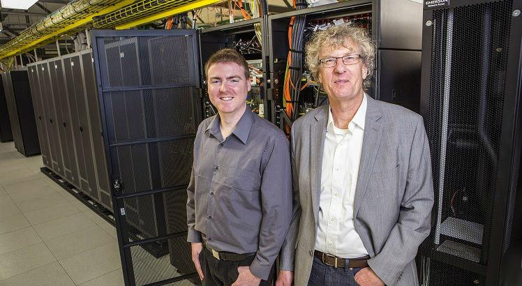 "This handout photo taken on September 6, 2016 and released on September 26, 2016 shows University of Canterbury alumni composer Jason Long (L) and professor Jack Copeland (R) in the UNIVER Blue Gene computer area. New Zealand researchers said on September 26 they have restored the first recording of computer-generated music, created in 1951 on a gigantic contraption built by British genius Alan Turing. / AFP PHOTO / UNIVERSITY OF CANTERBURY / STR / -----EDITORS NOTE --- RESTRICTED TO EDITORIAL USE - MANDATORY CREDIT ""AFP PHOTO / UNIVERSITY OF CANTERBURY"" - NO MARKETING - NO ADVERTISING CAMPAIGNS - DISTRIBUTED AS A SERVICE TO CLIENTS - NO ARCHIVES"