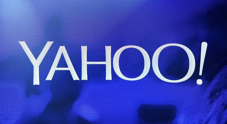 """(FILES) This file photo taken on January 06, 2014 shows a Yahoo! logo  on a screen during a keynote address by Yahoo! President and CEO Marissa Mayer at the 2014 International CES at The Las Vegas Hotel & Casino in Las Vegas, Nevada.  Yahoo said September 22, 2016 a massive attack on its network in 2014 accessed data from at least 500 million users and may have been """"state sponsored."""" """"Based on the ongoing investigation, Yahoo believes that information associated with at least 500 million user accounts was stolen,"""" a statement from the US Internet giant.  / AFP / GETTY IMAGES NORTH AMERICA / Ethan Miller"""